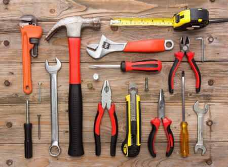 peen: A portrait of a mechanical kit in wooden background. construction tool
