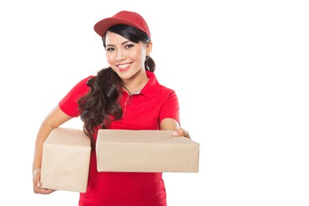 asian lady: Portrait of Female delivery service happily delivering package to costumer Stock Photo