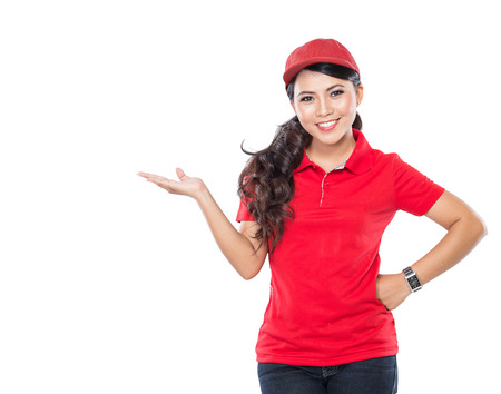 courier delivery: A portrait of a delivery young asian woman presenting to copyspace isolated in white background Stock Photo