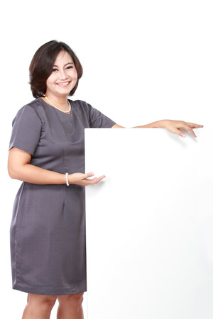 blank area: smiling business woman showing blank signboard, isolated on white background