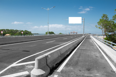 highroad: Blank White Blank board or billboard or roadsign in the road under the bright blue sky
