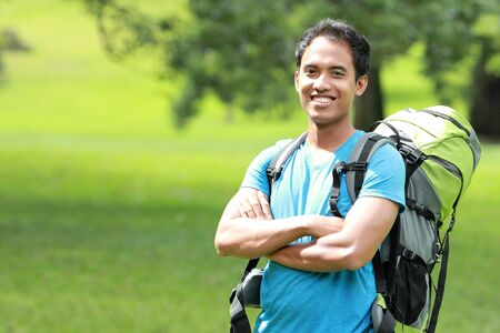 backpacking: A portrait of a young asian man travel backpacking, outdoor Stock Photo