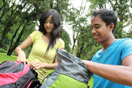 knapsacks: A portrait of a young asian couple preparing to backpacking on the mountain Stock Photo