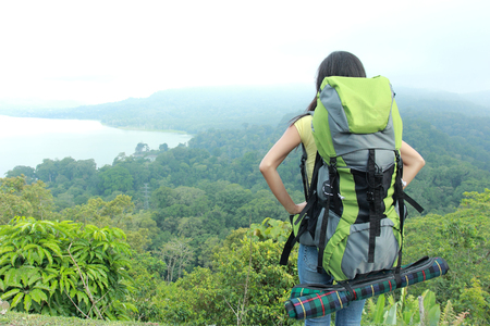 backpacking: A portrait of a young asian woman travel backpacking, outdoor