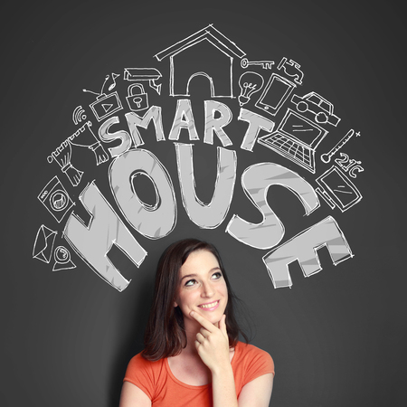 technolgy: Happy young woman looking up to the illustration of automation technolgy of smart house concept