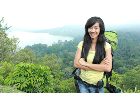 knapsacks: A portrait of a young asian womantravel backpacking, outdoor