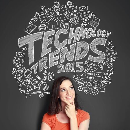 woman looking up: portrait of young woman looking up thinking about new technology trends on 2015 Stock Photo