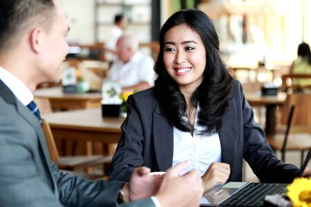 asian businesswoman: portrait of two business people meeting at coffee shop