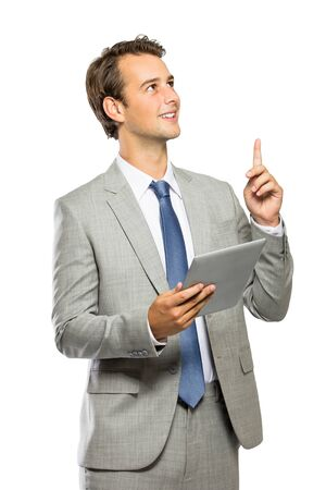 young businessman got an idea after reading an article on tablet isolated on white