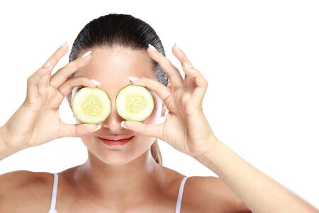 natural face: portrait of caucasian woman holding slices of cucumber for make up mask isolated in white