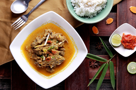 indonesian food: top view portrait of indonesian food gulai kambing served with rice