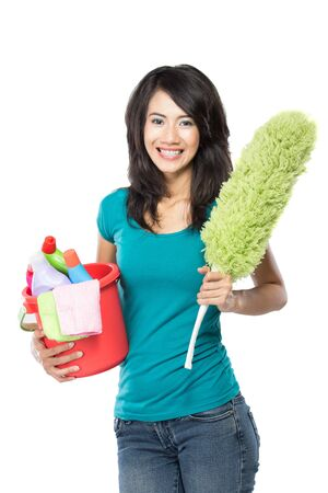 domestic chores: A portrait of a beautiful young asian woman holding a basket full of cleaning products ready to do a domestic chores Stock Photo
