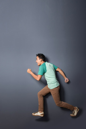 man in air: full body portrait of young man running in the air with copy space Stock Photo