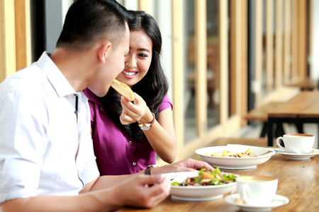 having lunch: portrait of romantic couple dating and having lunch together