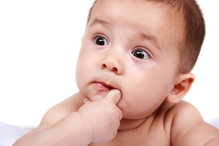 face of baby: cute expressions of baby sucking his little fingers isolated in white