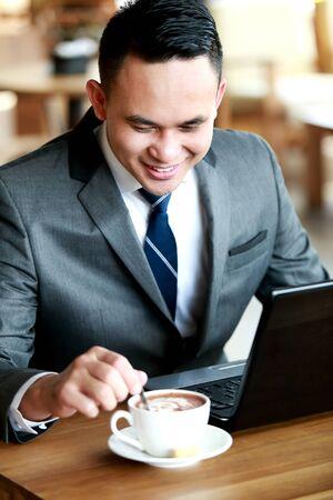 stirring: portrait of businessman stirring his coffee Stock Photo