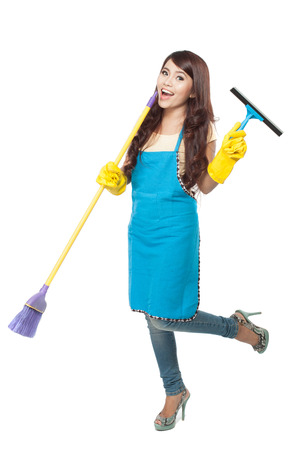 domestic chores: A portrait of a Young asian woman happily doing domestic chores, isolated