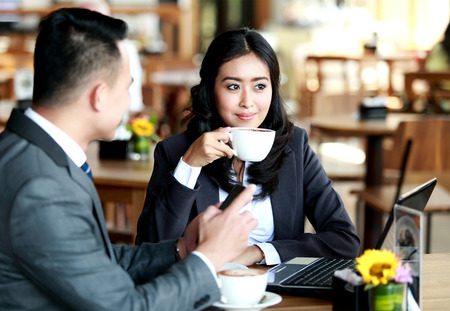 women coffee: portrait of business couple having a coffee break