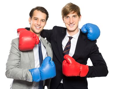 uomo rosso: portrait of two businessmen wearing boxing gloves isolated in white Archivio Fotografico