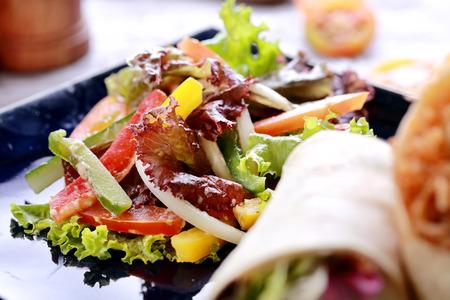 prawn: close up portrait of mexican mango salsa with burritos Stock Photo