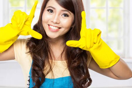 latex gloves: A portrait of a Young asian woman playing around with a  yellow latex gloves on