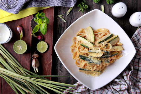 western food: top view portrait of italian fettuccini zucchini