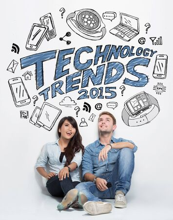 mixed couple: A portrait of mixed couple thinking about technology trends, illustrated things Stock Photo