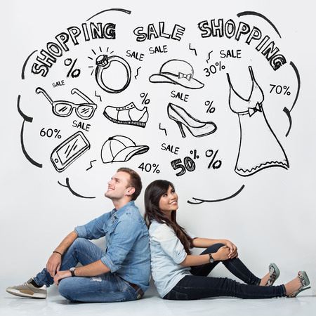 woman looking up: A portrait of a mixed couple imaginating about shopping, ilustrated things, isolated in white background