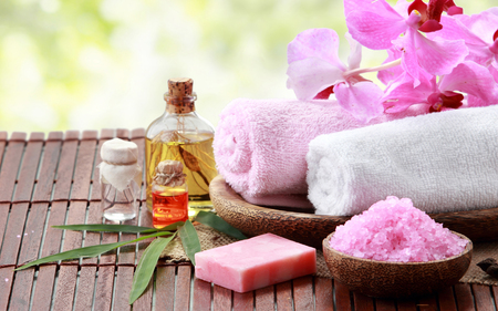 cosmetic product: Spa still life with essential oil, salt, orchid and towel Stock Photo