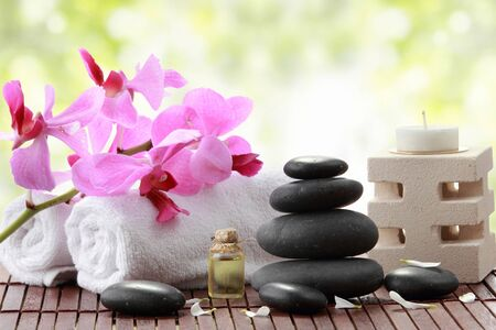 dry stone: A portrait of Essential oil , candle, towel and stones for spa teraphy Stock Photo