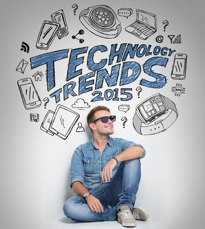 technology trends: A portrait of young man thinking about technology trends, illustrated things