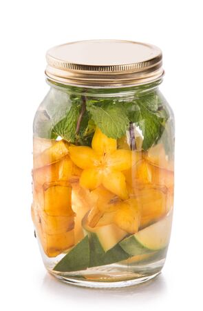 isolated on white: Summer fresh fruit Flavored infused water mix of mango, starfruit and mint isolated over white background