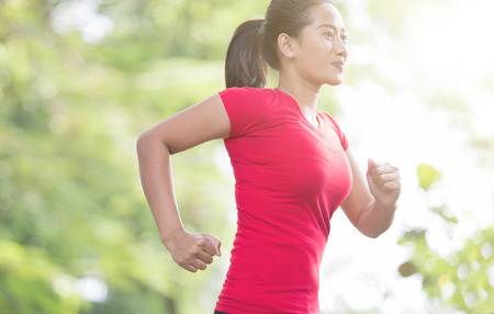 young asian: A portrait of a young asian woman jogging at the park