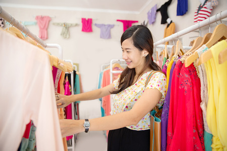 lifestyle shopping: portrait of young beautiful asian woman shopping in clothing store