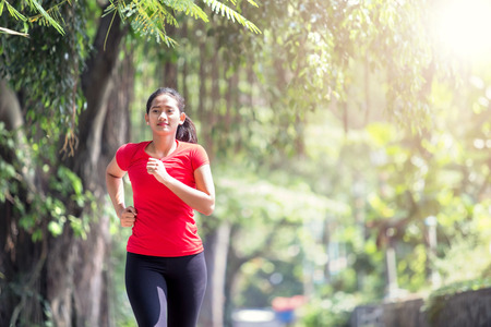 Portrait of a young asian woman jogging at the park