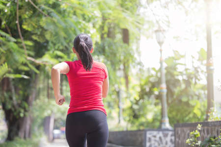 young asian: Portrait of a young asian woman jogging at the park