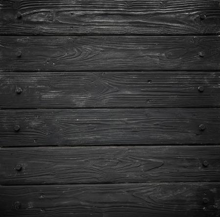 黒の木目テクスチャ。高詳細な写真で背景古いパネル