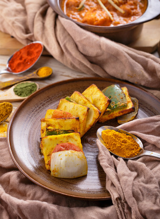 paneer: portrait of indian paneer tikka served with chicken tikka masala