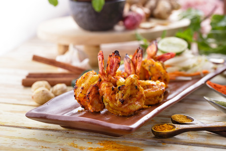 food dish: indian tandoori prawn spiced up with herbs and then grilled in tandoor