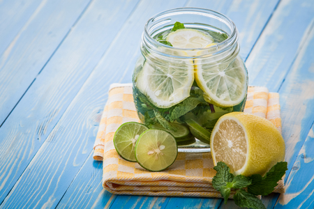 lemon water: Summer fresh fruit Flavored infused water mix of lemon, lime, and mint Stock Photo
