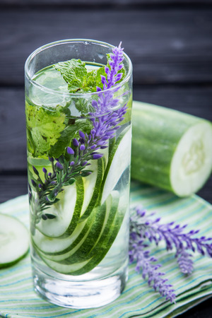 Summer fresh fruit Flavored infused water of cucumber and mint leaf Фото со стока