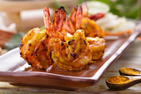 prawn: close up portrait of spicy indian tandoori prawn Stock Photo