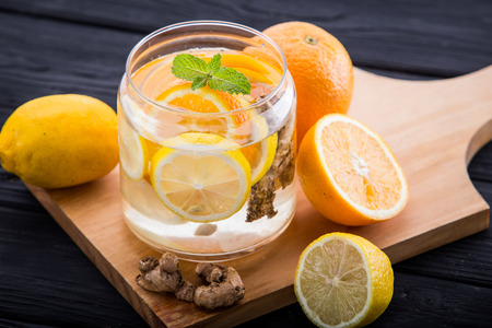 infused: Summer fresh fruit Flavored infused water of orange, lemon and ginger Stock Photo