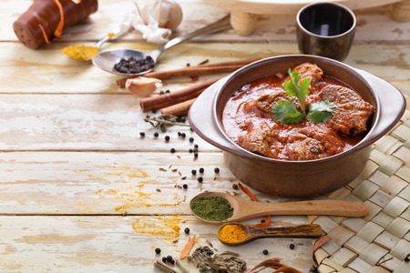 indian curry: portrait of indian lamb rogan josh with some seasoning