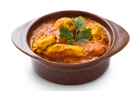 curry chicken: indian chicken curry served in pottery isolated on white background