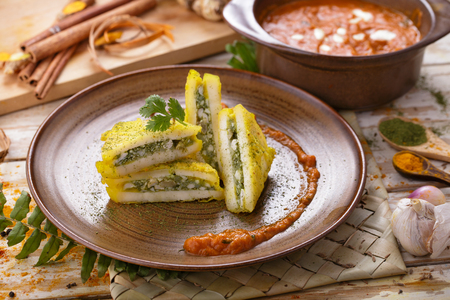 paneer: portrait of indian snack of paneer pasanda served with curry sauce Stock Photo