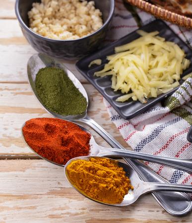 paneer: close up portrait of herbs seasoning on spoons and paneer