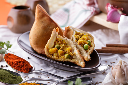 indian spice: portrait of spicy indian pastry samosa Stock Photo