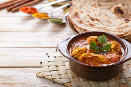 grill chicken: portrait of indian chicken curry and prata bread  with copyspace Stock Photo