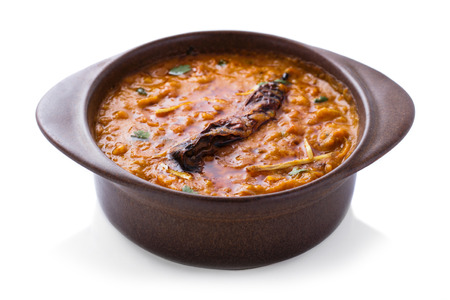 indian cuisine: indian cuisine dal tadka served in pottery isolated on white background